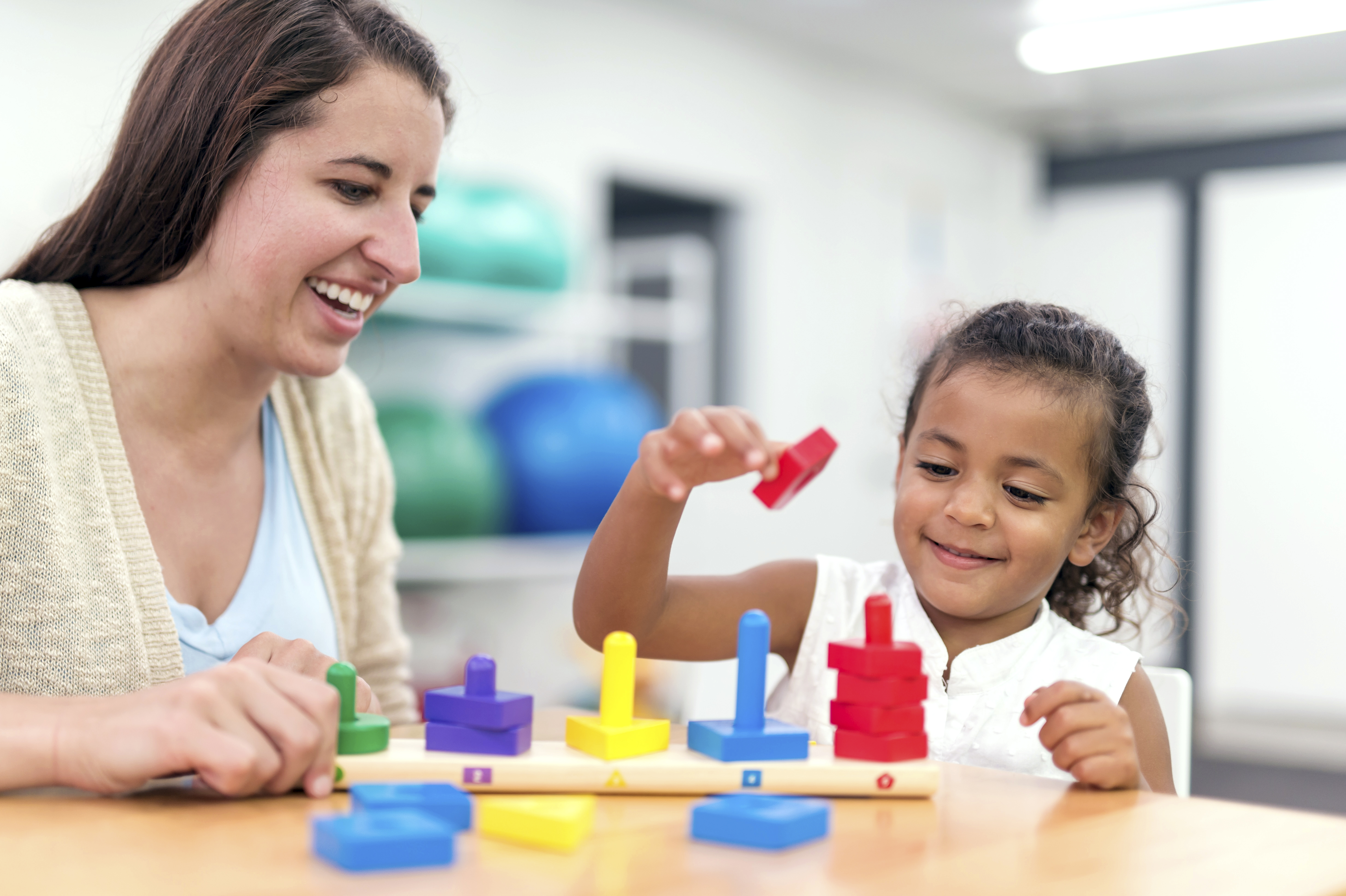 Early childhood intervention client engages in occupational therapy