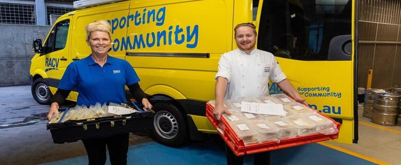 Two RACV employees delivering food